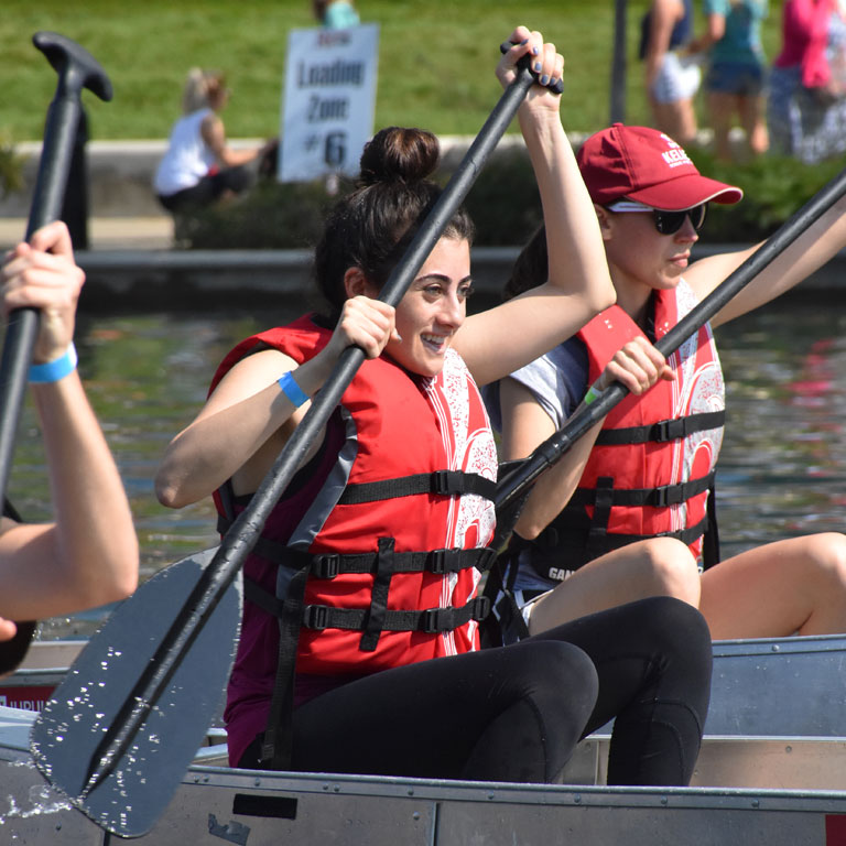 Students paddle on the water in IUPUI's annual Regatta.